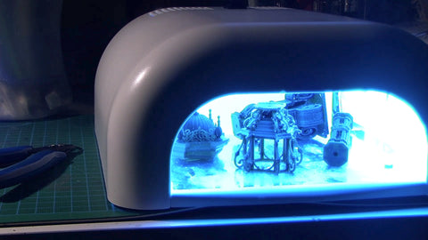 use UV lamps to clean the resin remains