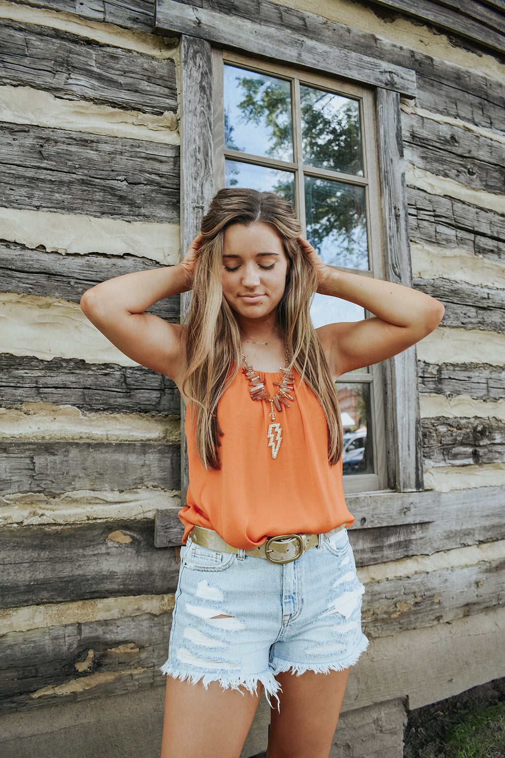 A LITTLE TIED UP IN ORANGE TOP