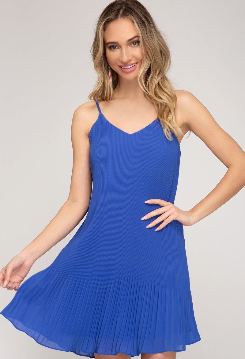 THE PLEAT IS ON BLUE DRESS