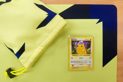 little spark playmat and red cheeks pikachu