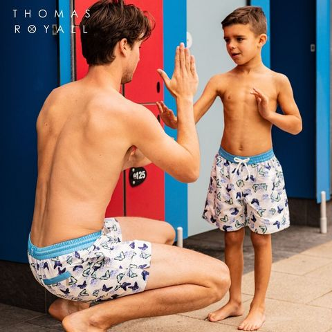 father and son in swim shorts