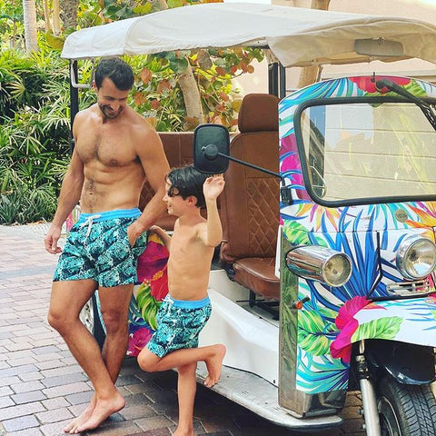 father and son wearing matching swim shorts