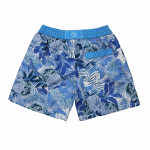 Argentina' kids swim shorts features a contrasting floral leaf design. This 'Luca' style features our signature Thomas Royall blue waistband.