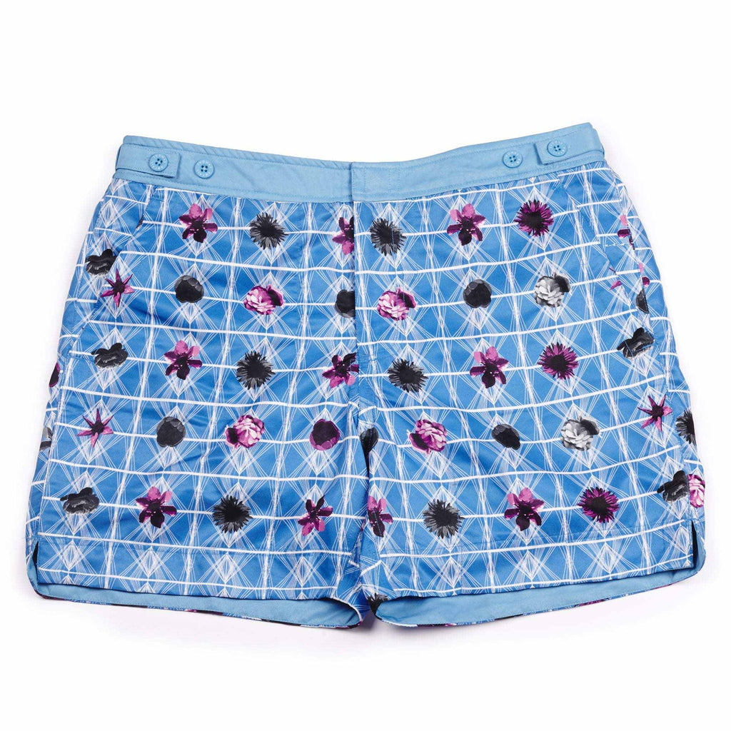 Our geometric 'Bahamas' shorts featuring a contrasting floral design. The 'George' fit features our signature Thomas Royall blue waistband with a smart tailored fit.