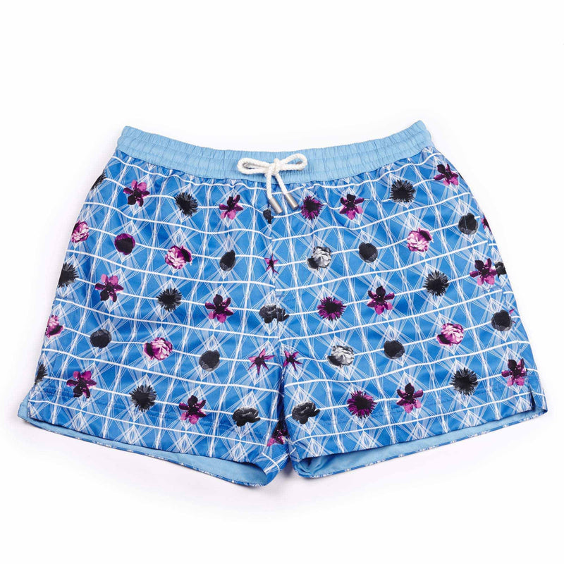 Our geometric 'Bahamas' shorts featuring a contrasting floral design. The 'Luca' fit features our signature Thomas Royall blue waistband with a relaxed day to night fit.