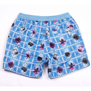 Our geometric 'Bahamas' shorts featuring a contrasting floral design in royal blue with fuchsia pink & black small floral details. All kids swim shorts finished with our signature Thomas Royall azure blue, elasticated waistband.