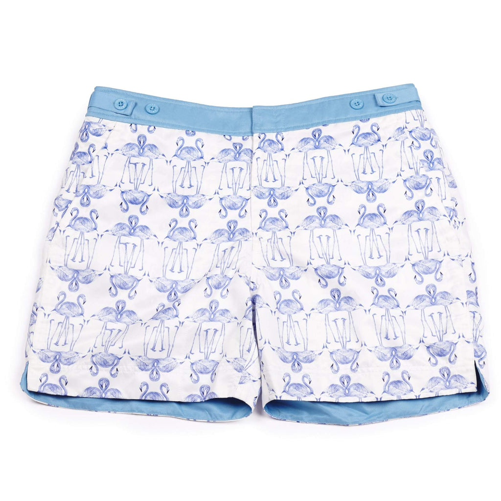 Our 'Barbados' shorts featuring a graphical flamingo design in white and purple. This 'George' fit features our signature Thomas Royall blue waistband with a smart tailored fit.