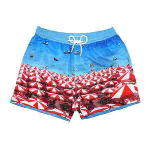 Our 'Barcelona Beach' kids shorts featuring a seaside scene of parasols and umbrella design. Matching design in our mens Luca design available.
