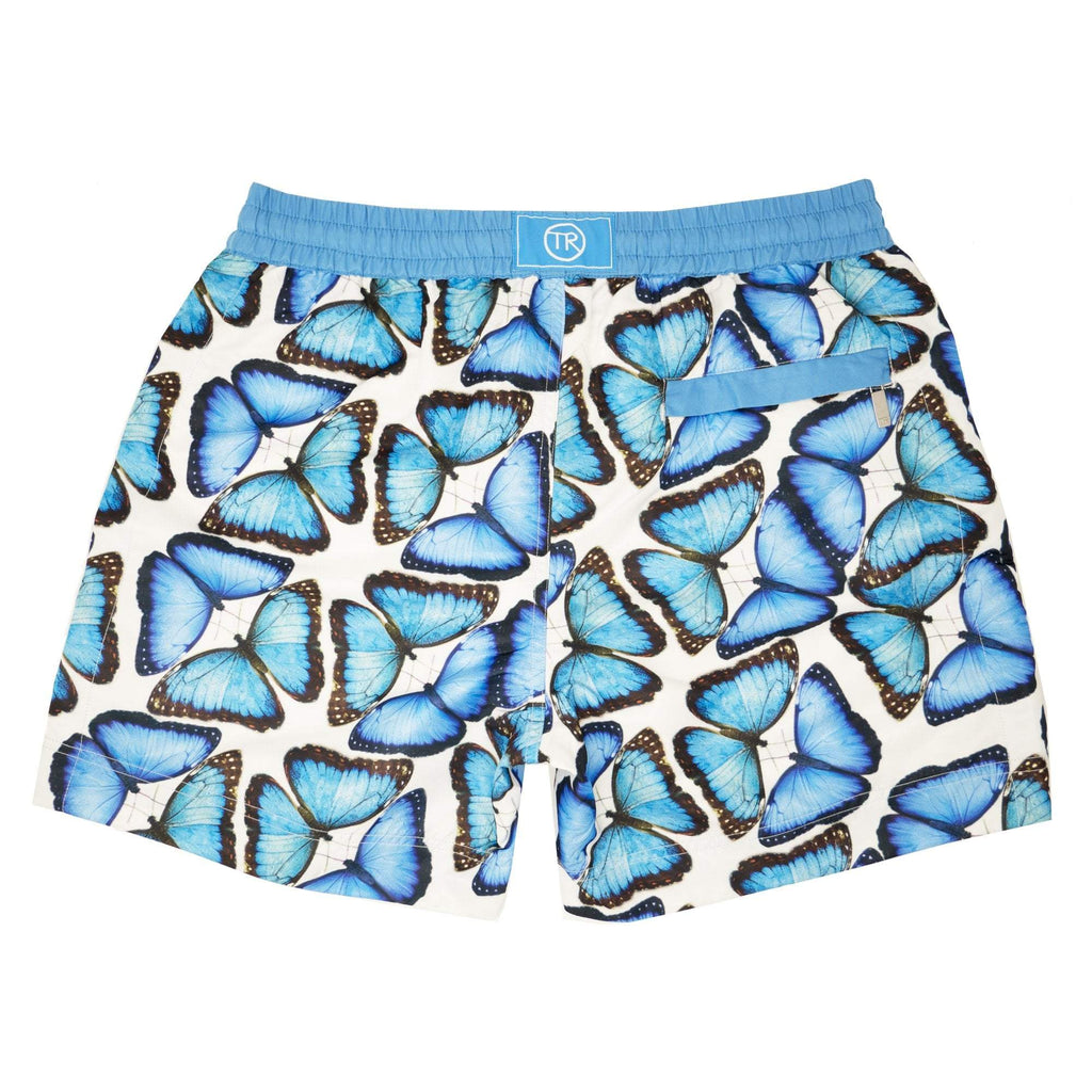 Our signature 'Bermuda' kids shorts featuring our iconic large scattered butterflies in cooling shades of blue.