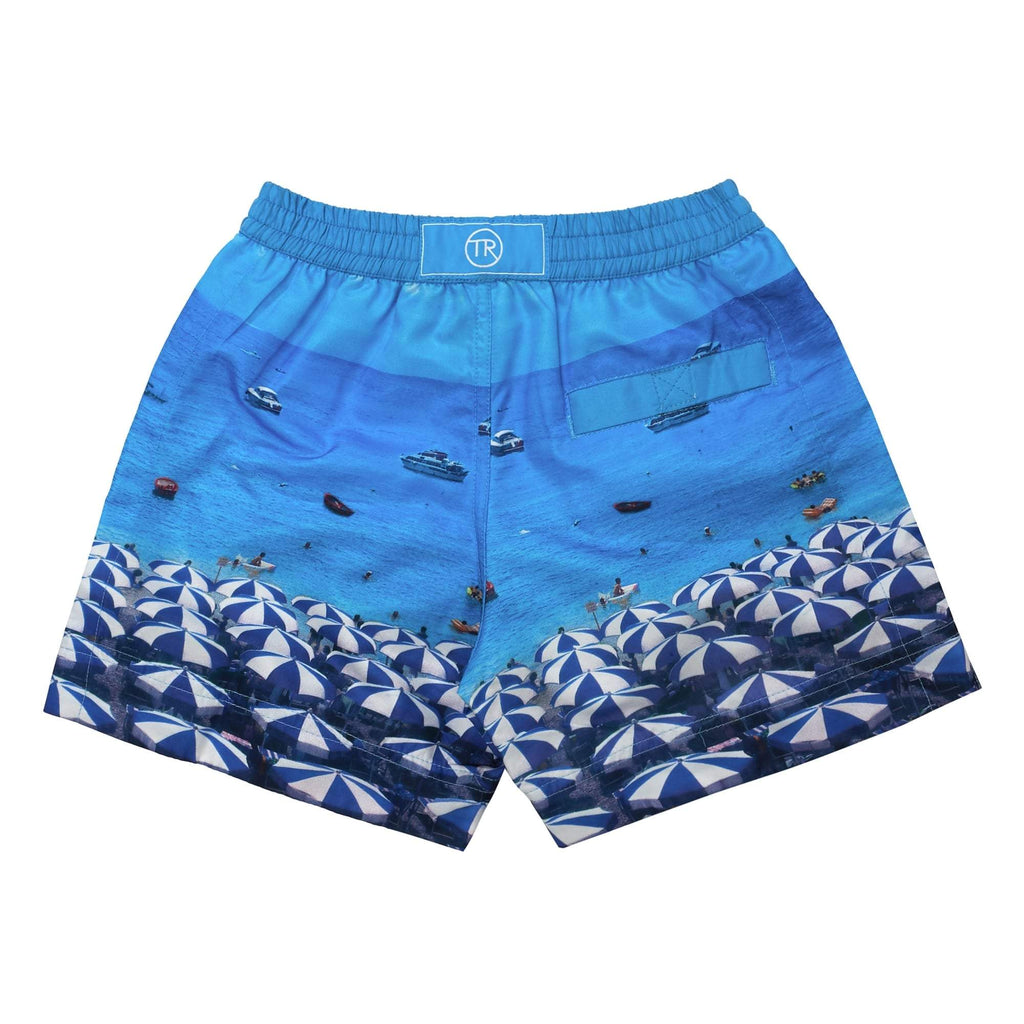 Bondi Beach' kids shorts showcasing a parasol umbrella holiday design. This 'Luca' style features our signature Thomas Royall blue waistband.