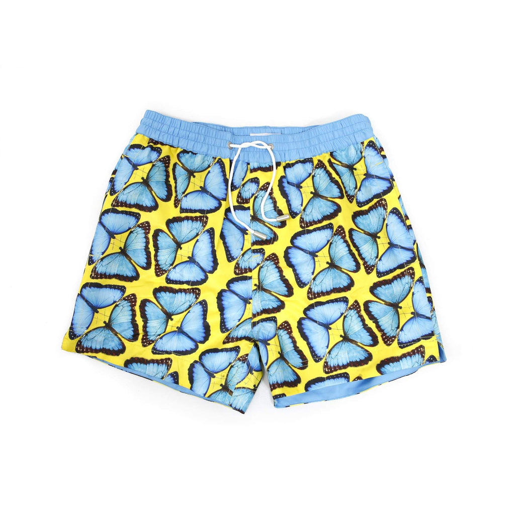 Our bright 'Brazil' kids shorts featuring a mirrored butterfly design in popping blue and yellow.