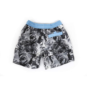 Our limited edition 'Florida' kids shorts featuring a triangle black and white rose design. The 'Luca' fit features our signature Thomas Royall blue waistband. Matching Mens George short available.