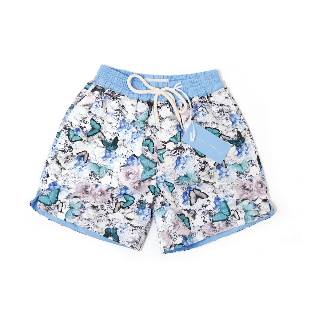 Our multi coloured 'Hawaii' kids shorts featuring a floral and butterfly design.