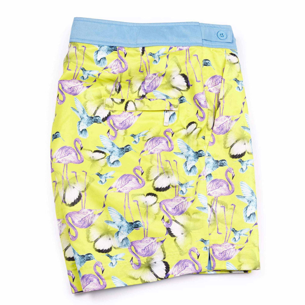 Colourful 'Jamaica' yellow shorts featuring a flamingo, bird and butterfly design. This 'George' fit features our signature Thomas Royall blue waistband with a smart tailored fit.