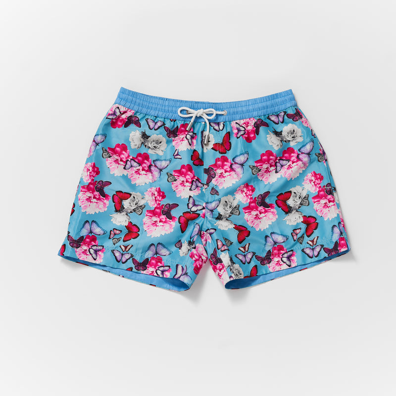 Matching mens and boys Thomas Royall swim short in Blue with pink butterfly pattern