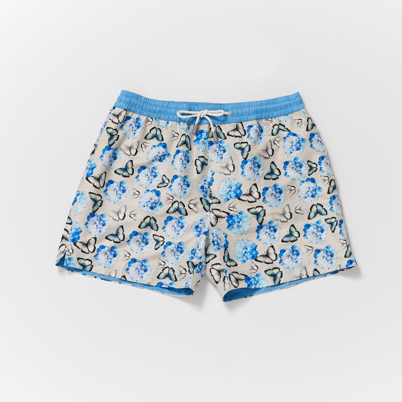 Matching mens and boys Thomas Royall swim shorts in silver grey with blue butterfly pattern and blue waistband