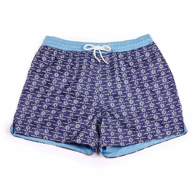 Our 'Manhattan' shorts featuring a navy and white geometric design. The 'Luca' fit features our signature Thomas Royall blue waistband with a relaxed day to night fit.