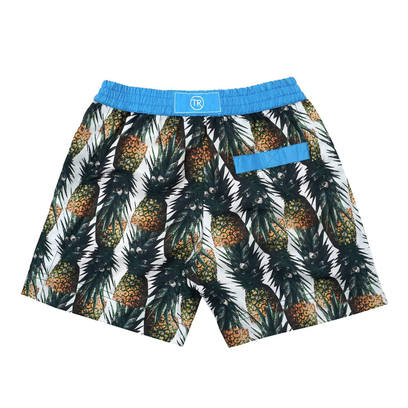 Montego' kids shorts showcasing a fruity pineapple design. This 'Luca' style features our signature Thomas Royall blue waistband with a relaxed day to night fit.