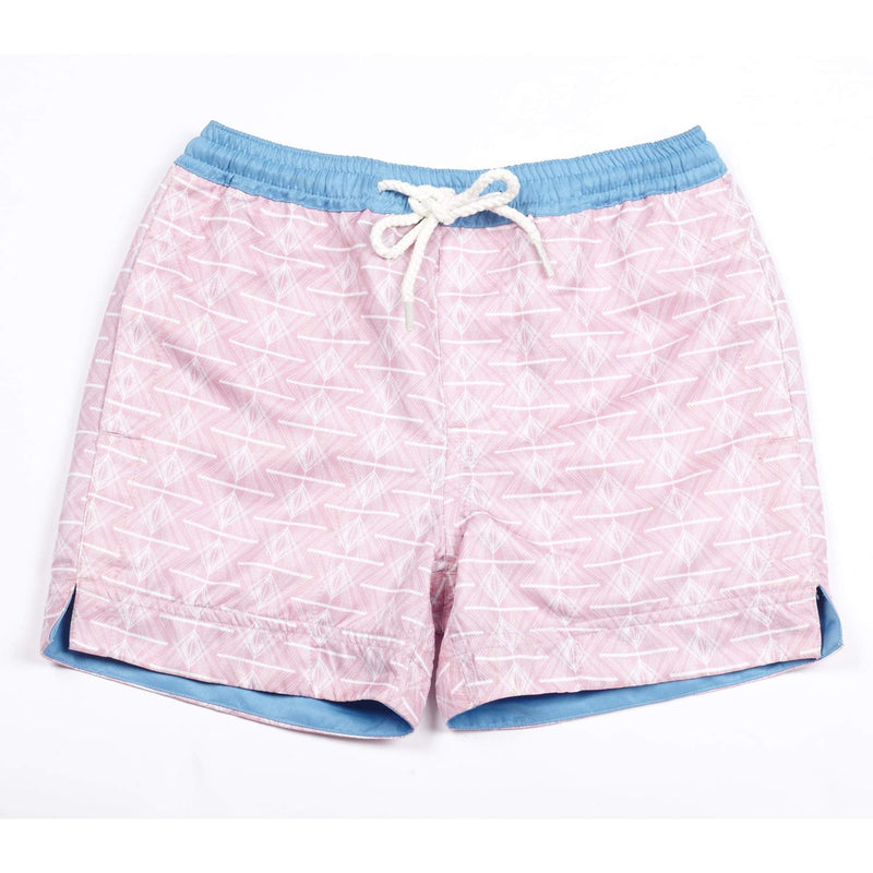 Our 'Queensland' kids shorts featuring a pink and white geometric design.