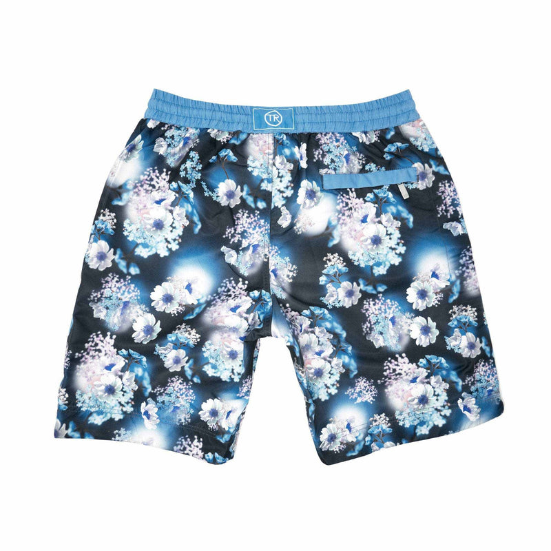 Our 'Spain' shorts showcasing a 3D floral design. This 'Bobby' style features our signature Thomas Royall blue waistband with a mid length, relaxed day to night fit.