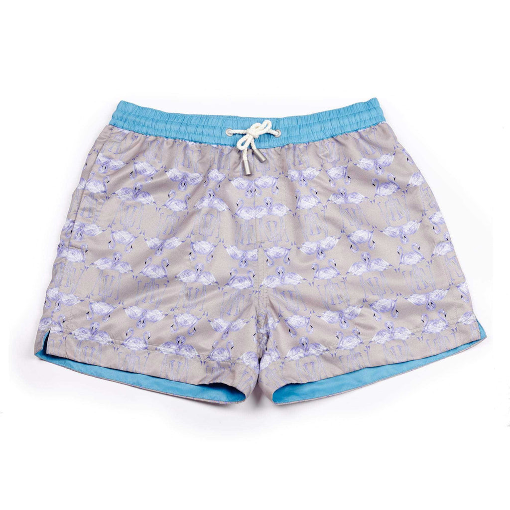 The 'St Lucia' shorts with a graphic flamingo design. The 'Luca' fit features our signature Thomas Royall blue waistband with a relaxed day to night fit.