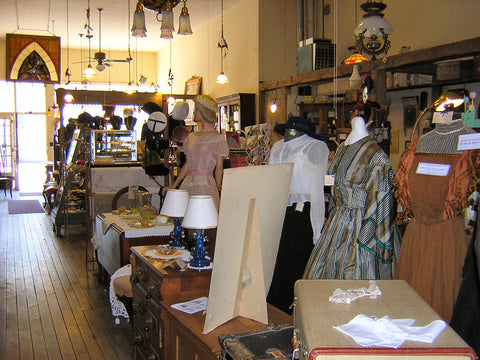 Brick and mortar shop display of antique dresses