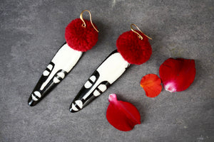 Bone Mask Earrings and pompoms
