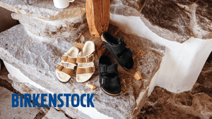 two pairs of two strap furry sandals with natural background and words birkenstock in blue