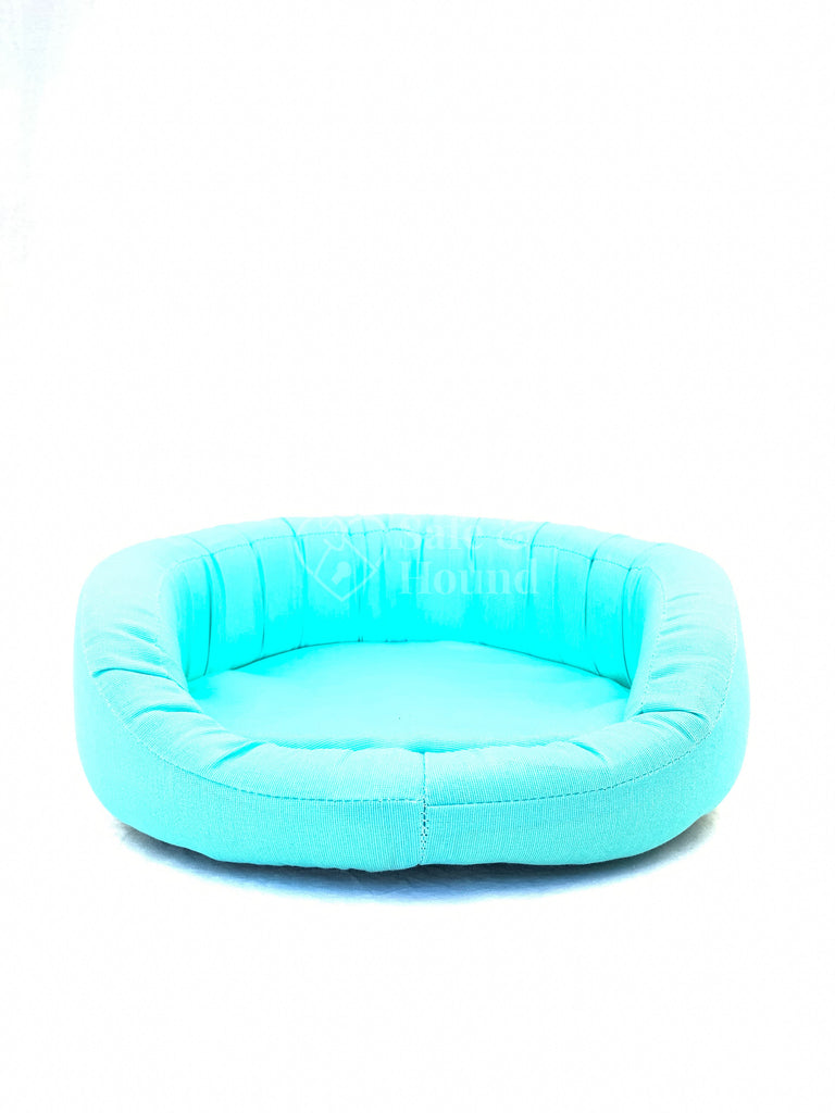 Front view of a Bolster Bed size S in aqua blue canvas.