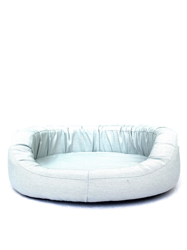 Front view of a Bolster Bed size S in pearl grey canvas.