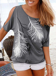 Cold Shoulder blouse with a feather design on front.