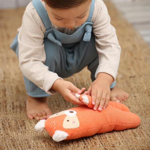 Boy playing with Albetta towelling toy fox with pouch