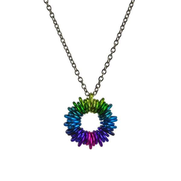 "Coiled Pendant in Electric Rainbow by Rebeca Mojica. Approximately 40 small anodized aluminum jump rings are added to a larger jump ring forming a ""coil"" motif. The colors range from lime to teal to turqouise to blue to purple to violet to pink and back again."