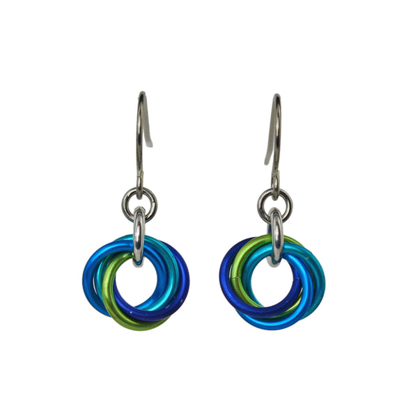 closeup of Minimalist chainmaille earrings in turquoise, blue and chartreuse on white background