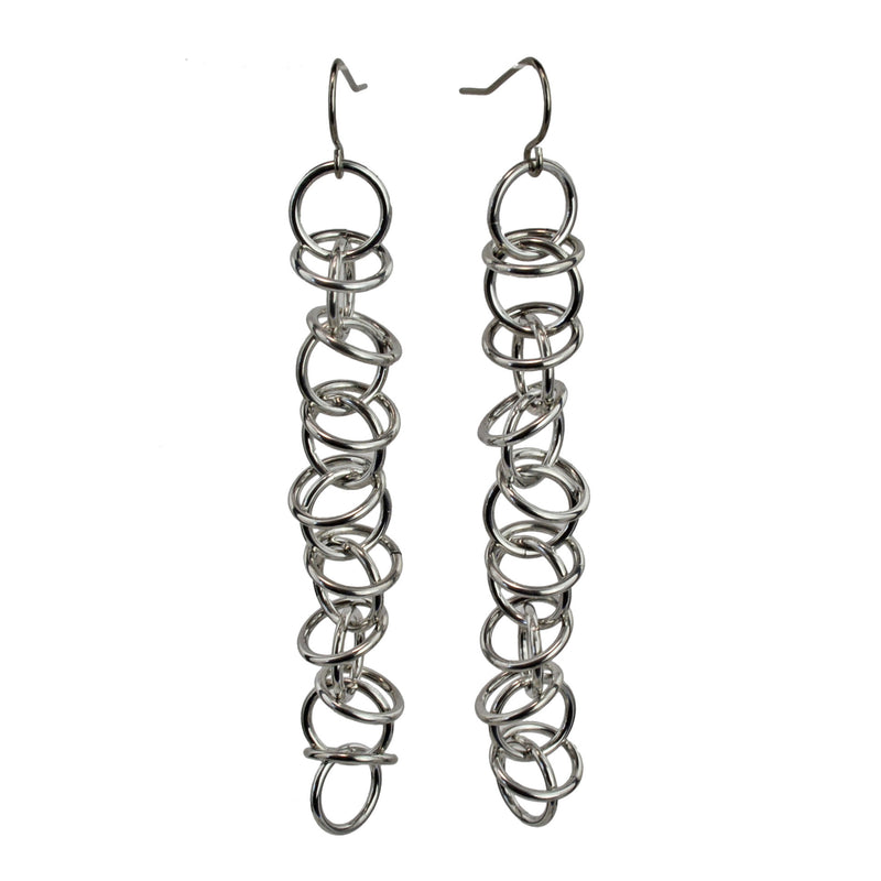 Long Orbital earrings with silver color aluminum jump rings by Rebeca Mojica Jewelry.