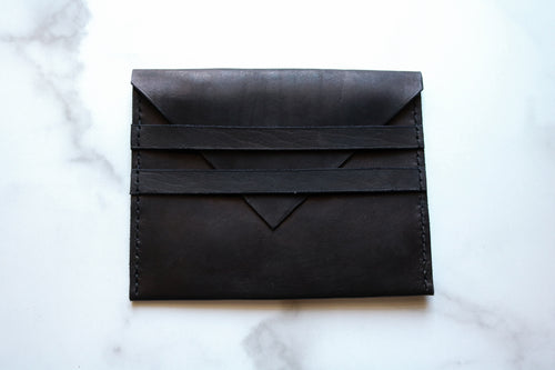Yonnah Leather Two Strap Clutch in Black