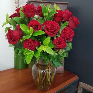 Two Dozen Roses in Glass Vase