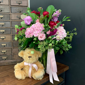 Flowers in A Vase With Teddy