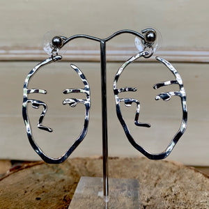 Cutout Face Silver Earrings