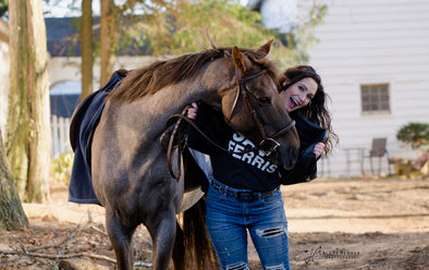 Heather Wallace, Confessions of a Timid Rider writer, with her horse Ferrous.