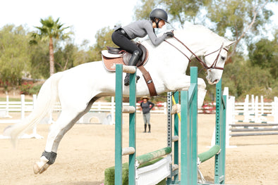 Helen Pollock from Life Equestrian at Storia Stables jumping with a CWD Saddle