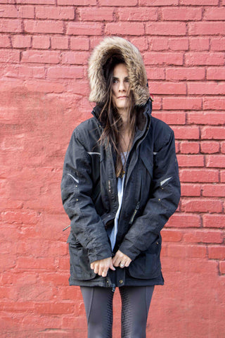 Andrea Wise wears the mountain horse jacket to stay warm from the cold weather.