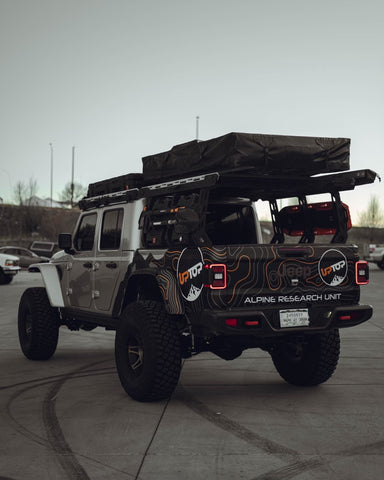 Jeep gladiator outfitted with upTOP overland roof rack and bed rack