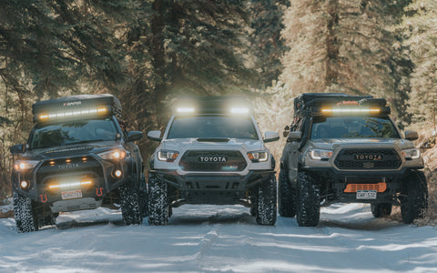 Line up of upTOP vehicles with roof racks on a 4Runner and Tacoma
