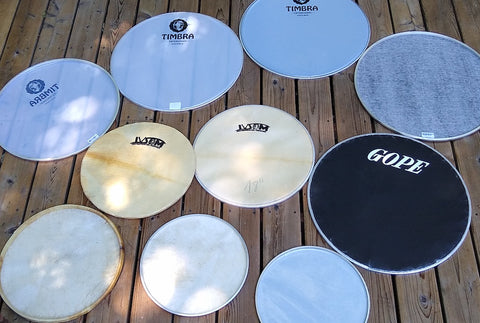 Surdo heads in many types. Timbra, IVSOM, and GOPE. Napa, plastic, goat skin, and inverted napa.