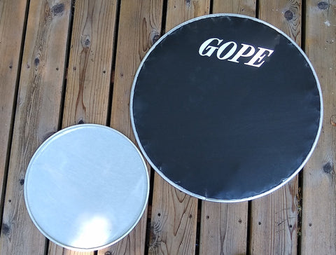 Napa drum surdo head. Front side of and back side of head shown. GOPE logo.