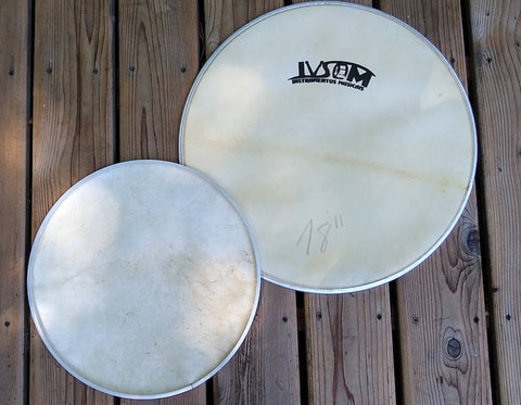 Goat skin head embedded in an aluminum hoop. IVSOM logo, front side of drum head and back side shown.