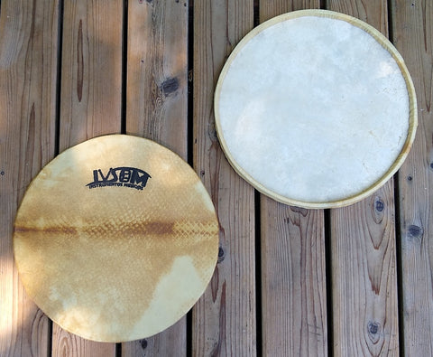 Goat skin surdo head around a wooden hoop. Front side and back side of head shown. Front view has an IVSOM logo showing.