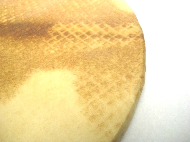 Zoomed in view of top side of goat skin surdo head.