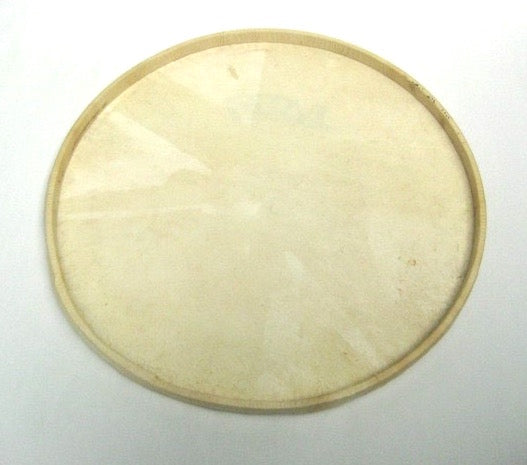Bottom view of first surdo drum head made of goat skin wrapped around a wooden hoop.